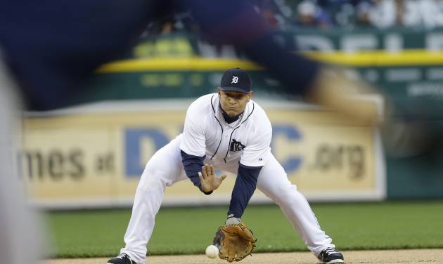 Detroit Tigers third baseman Miguel Cabrera fields an out from Minnesota Twins' Jamey Carroll during the first inning of a baseball game in Detroit, Thursday, May 23, 2013. (AP Photo/Carlos Osorio)