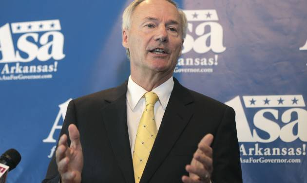 Republican candidate for Arkansas governor Asa Hutchinson speaks to reporters in Little Rock, Ark., Monday, Aug. 4, 2014. Hutchinson is vowing to join a lawsuit that 12 other states have joinedchallenging the federal's government's proposed rules for power-plant pollution. (AP Photo/Danny Johnston)