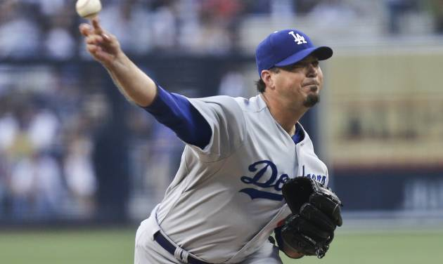 Los Angeles Dodgers starting pitcher Josh Beckett releases a pitch against the San Diego Padres during the first inning of a baseball game Saturday, June 21, 2014, in San Diego. (AP Photo/Lenny Ignelzi)