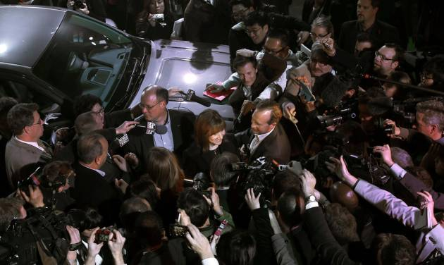 Incoming General Motors CEO Mary Barra is surrounded by media at the debut of the 2015 GMC Canyon during media previews for the North American International Auto Show, Sunday, Jan. 12, 2014, in Detroit. (AP Photo/Paul Sancya)