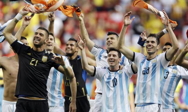 Argentina's Lionel Messi (10) and his teammates celebrate following their 1-0 victory over Belgium to advance to the semifinals after the World Cup quarterfinal soccer match at the Estadio Nacional in Brasilia, Brazil, Saturday, July 5, 2014. (AP Photo/Kirsty Wigglesworth)