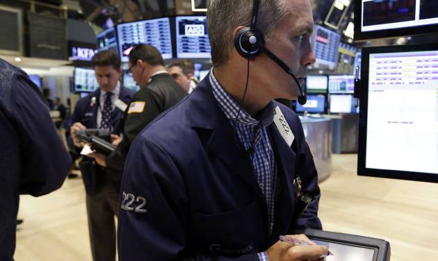 In this Friday, June 28, 2013, photo, Trader Timothy Nick, right, works on the floor of the New York Stock Exchange. Asian stock markets floundered Friday July 26, 2013 as China pressed ahead with industrial restructuring that is partly to blame for slowing growth in the world's No. 2 economy. (AP Photo/Richard Drew)