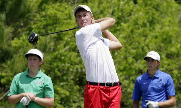 Chris Karlovich of Bishop Kelley tees off on the 16th hole as Kevin Daly of Bishop McQuinness (left) and Brady Bellinger of Deer Creek look on in the final round of the 5A State Championship Golf Tournament at the Tulsa Country Club in Tulsa, OK, May 7, 2013. MICHAEL WYKE/Tulsa World ORG XMIT: DTI1305071709332256