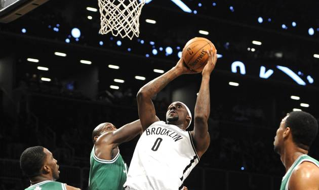 Brooklyn Nets' Andray Blatche (0) shoots around Boston Celtics' Jeff Green (8), Kevin Garnett (5), Courtney Lee (11) and Jared Sullinger, right, during the first half of an NBA basketball game on Thursday, Nov., 15, 2012, at Barclays Center in New York. (AP Photo/Kathy Kmonicek)