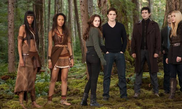 """FILE- This undated file photo provided by Summit Entertainment shows, from left, Judith Shekoni, Tracey Heggins, Kristen Stewart, Robert Pattinson, Christian Camargo, Peter Facinelli and Casey LaBow in a scene from the film """"The Twilight Saga: Breaking Dawn - Part 2."""" The finale to the blockbuster supernatural romance dominated the 33rd Annual Razzie Awards on Saturday, Feb. 23, 2013 with seven awards, including worst actress for Kristen Stewart, supporting actor for Taylor Lautner, director for Bill Condon and worst screen couple for Lautner and child co-star Mackenzie Foy. (AP Photo/Summit Entertainment, Andrew Cooper, SMPSP, File)"""