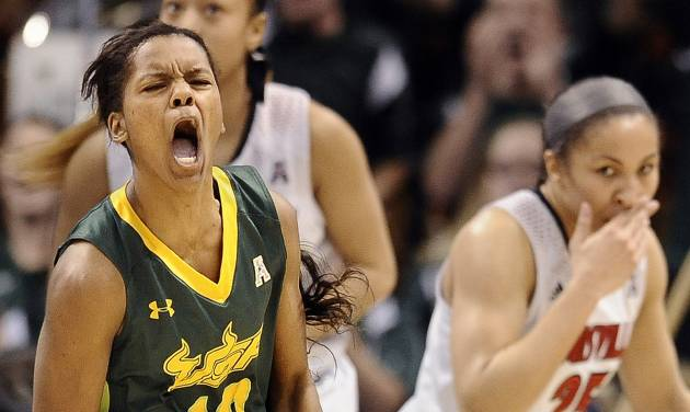 South Florida's Courtney Williams, left, reacts during the second half of an NCAA college basketball game against Louisville in the semifinals of the American Athletic Conference women's tournament, Sunday, March 9, 2014, in Uncasville, Conn. Louisville won 60-56. (AP Photo/Jessica Hill)