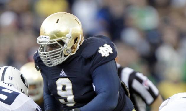 In this Saturday, Oct. 20, 2012, photo, Notre Dame defensive lineman Louis Nix III rushes during the second half of an NCAA college football game against Brigham Young in South Bend, Ind. Nix seems to always find himself in the middle of things, whether itís on the field clogging things up along the line for the Fighting Irish defense or videotaping the latest YouTube segment of his ìChocolate Newsî that gives fans a behind-the-scenes look at the team. (AP Photo/Michael Conroy)
