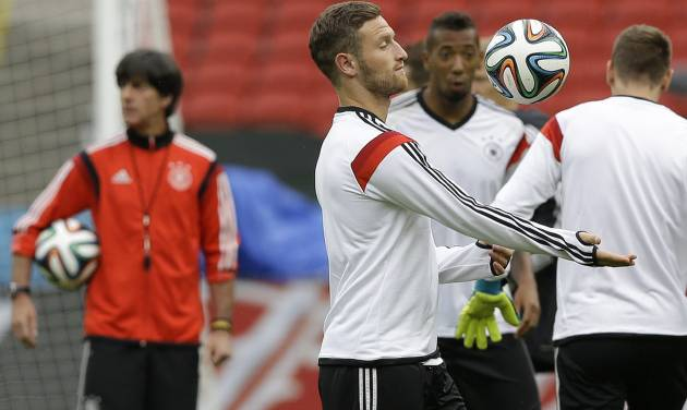 Germany's soccer team player Shkodran Mustafi bounces the ball off his arm during a training session at the Estadio Beira-Rio Stadium in Porto Alegre, Brazil, Sunday, June 29, 2014. Germany will play Algeria in a World Cup round of 16 soccer match on June 30. (AP Photo/Kirsty Wigglesworth)
