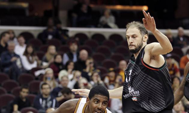 Cleveland Cavaliers' Kyrie Irving (2) drives past Montepaschi Siena's Victor Sanikidze (13) in the second quarter of a preseason NBA basketball game, Monday, Oct. 8, 2012, in Cleveland. (AP Photo/Tony Dejak)
