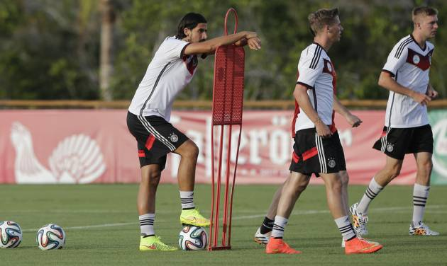 Germany's national soccer players Sami Khedira, from left, Erik Durm and Christoph Kramer attend a training session in Santo Andre near Porto Seguro, Brazil, Wednesday, June 18, 2014. Germany play in group G of the 2014 soccer World Cup. (AP Photo/Matthias Schrader)