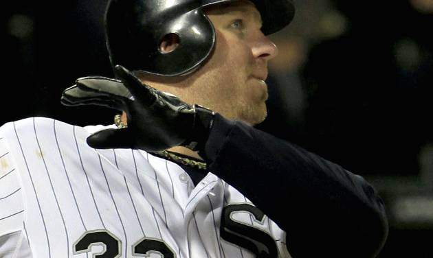 Chicago White Sox's Adam Dunn watches his three-run homer against the Cleveland Indians head for the wall during the eighth inning of a baseball game, Monday, Sept. 24, 2012, in Chicago. (AP Photo/John Smierciak)