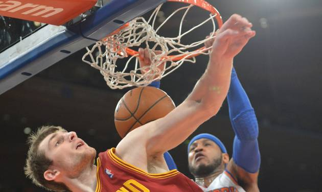 New York Knicks' Carmelo Anthony dunks the ball over Cleveland Cavaliers' Tyler Zeller (40) during the first quarter of an NBA basketball game Thursday, Jan. 30, 2014, at Madison Square Garden in New York. (AP Photo/Bill Kostroun)