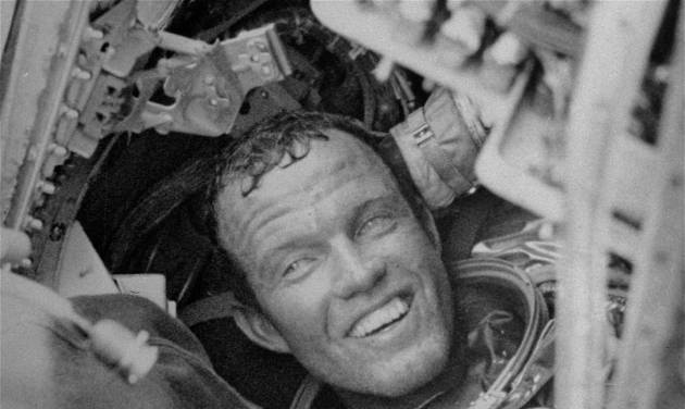 Astronaut Gordon Cooper is all smiles as he prepares to leave his Faith 7 Mercury space capsule after his record-breaking flight. (NASA photo)