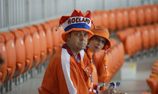 Dutch fans take their seat ahead of the women's 1,000-meter speedskating race at the Adler Arena Skating Center during the 2014 Winter Olympics in Sochi, Russia, Thursday, Feb. 13, 2014. (AP Photo/David J. Phillip )