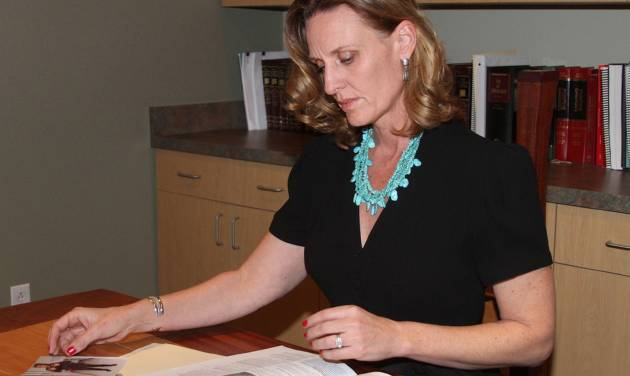 "FILE - This Jan. 26, 2012 file photo shows attorney Shannon Kennedy looking through a case file involving a school-aged child who was placed in handcuffs for ""non-violent misdemeanors"" and was charged with ""interfering with the education process,"" in Albuquerque, N.M. ""Kids are being arrested for being kids,"" said Kennedy, who has filed a class-action lawsuit against Albuquerque public schools on behalf of hundreds of students arrested for nonviolent crimes last year. (AP Photo/J.R. Oppenheim, File)"