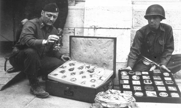 "This photo provided by The Monuments Men Foundation for the Preservation of Art of Dallas, shows Monuments Man James Rorimer, left, and Sgt. Antonio Valim examining valuable art objects at Neuschwanstein Castle in Germany which were stolen from the Rothschild collection in France by the ERR and found in the castle in May of 1945. Rorimer, a curator at the Metropolitan Museum of Art before the war who eventually became its director after returning, went on to achieve great success, helping to discover where works of art looted by the Nazis were tucked away across Europe. In the upcoming movie ""The Monuments Men,"" Matt Damon portrays a character inspired by the real-life Rorimer, who died in 1966 at the age of 60.  (AP Photo/National Archives and Records Administration)"