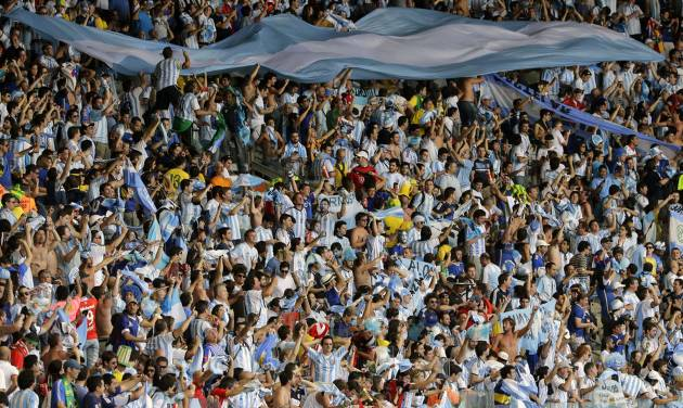 Argentina's fans celebrate after the group F World Cup soccer match between Argentina and Iran at the Mineirao Stadium in Belo Horizonte, Brazil, Saturday, June 21, 2014. Lionel Messi scored a superb goal in stoppage time to give Argentina a 1-0 victory over Iran.(AP Photo/Sergei Grits)