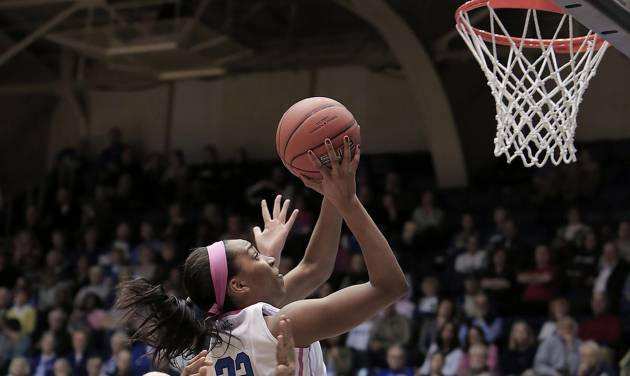 Duke's Oderah Chidom (22) drives to the basket ahead of Maryland's Shatori Walker-Kimbrough (32) during the first half of an NCAA college basketball game in Durham, N.C., Monday, Feb. 17, 2014. (AP Photo/Ted Richardson)