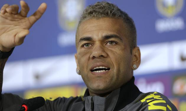 Brazil's Dani Alves gestures during a news conference at the Granja Comary training center in Teresopolis, Brazil, Saturday, June 21, 2014. Brazil plays in group A at the 2014 soccer World Cup. (AP Photo/Andre Penner)