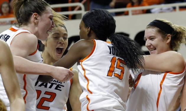 Oklahoma State's Lindsey Keller (25), Brittney Martin (22), Liz Donohoe (4) celebrate with Toni Young (15) during the women's college basketball game between Oklahoma State and Iowa State at  Gallagher-Iba Arena in Stillwater, Okla.,  Sunday,Jan. 20, 2013.  OSU won 71-42. Photo by Sarah Phipps, The Oklahoman