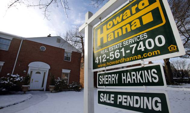 In this Thursday, Jan. 9, 2014, photo, a for sale sign is placed in front of a house in Mount Lebanon, Pa. Standard & Poor's releases S&P/Case-Shiller index of home prices for November, on Tuesday, Jan. 28, 2014. (AP Photo/Gene J. Puskar)