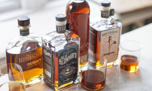This Apr. 7, 2014 photo shows Jefferson's Ocean, Old Blowhard, Eagle Rare, and Barterhouse bourbons in Concord, N.H. All are part of a bourbon renaissance that has seen a new appreciation of American whiskey, as well as the birth of a whole new class of cult spirits. (AP Photo/Matthew Mead)