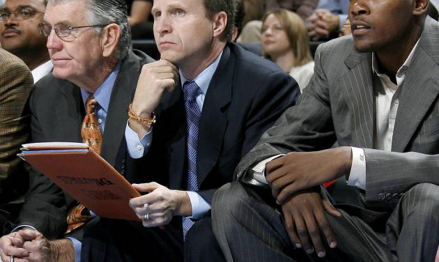 Former assistant coach Scott Brooks, center, has been named the Oklahoma City Thunder throughout the rest of the season, general manager Sam Presti said Saturday. Brooks replaces P.J. Carlesimo, who was fired following the Thunder's 25-point loss Friday to New Orleans. By Bryan Terry