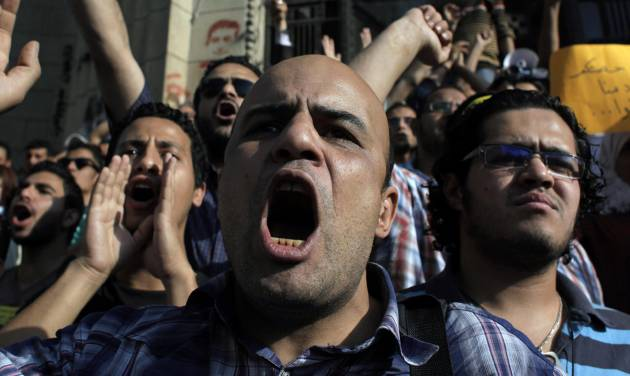 Egyptian protesters chant anti-ruling military council slogans during a rally demanding the release of fellow activists, detained during the army operation that dispersed a protest in front of the Ministry of Defense, in Cairo, Egypt Sunday, May 6, 2012. (AP Photo/Nasser Nasser)