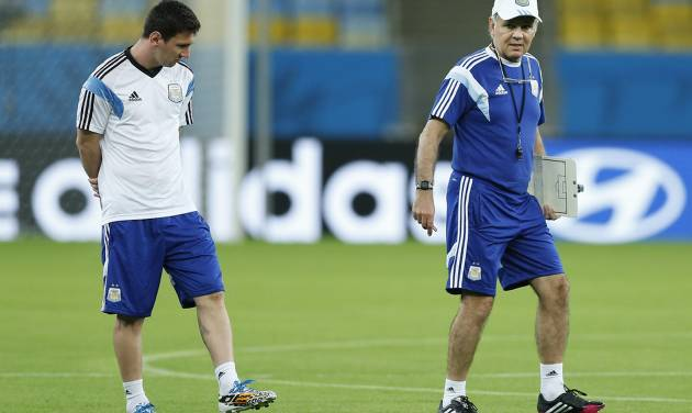 Argentina's Lionel Messi, left, and Argentina's head coach Alejandro Sabella, right, enter the Maracana Stadium in Rio de Janeiro, Brazil, Saturday, June, 14, 2014. Argentina will face  Bosnia-Herzegovina in group F of the 2014 soccer World Cup at the stadium on Sunday. (AP Photo/Victor R. Caivano)