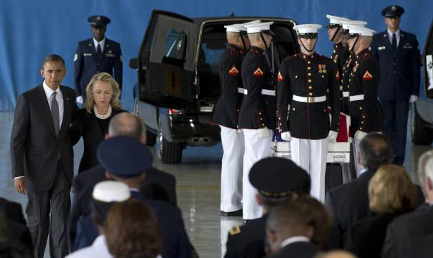 President Barack Obama and Secretary of State Hillary Rodham Clinton walk back to their seats after speaking during the Transfer of Remains Ceremony, Friday, Sept. 14, 2012, at Andrews Air Force Base, Md., marking the return to the United States of the remains of the four Americans killed this week in Benghazi, Libya. Behind them at right is one of the flag draped transfer cases of the remains of the four Americans killed this week in Benghazi, Libya. (AP Photo/Carolyn Kaster)