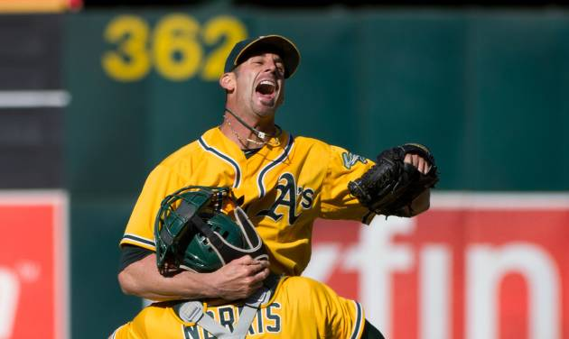 Oakland Athletics closer Grant Balfour celebrates with catcher Derek Norris after getting the last out in the team's 12-5 win over the Texas Rangers in a baseball game Wednesday, Oct. 3, 2012, in Oakland, Calif. The A's took the AL West title. (AP Photo/The Sacramento Bee, Jose Luis Villegas) MAGS OUT; TV OUT (KCRA3, KXTV10, KOVR13, KUVS19, KMAZ31, KTXL40) MANDATORY CREDIT