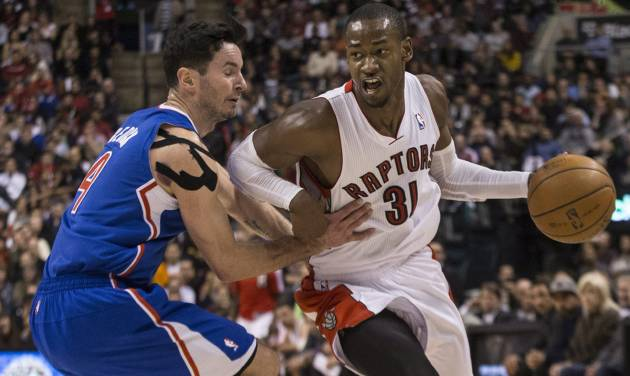 Toronto Raptors' Terrence Ross, (31) drives past Los Angeles Clippers' J.J. Redick during the second half of an NBA basketball game, Saturday, Jan. 25, 2014 in Toronto. (AP Photo/The Canadian Press, Chris Young)