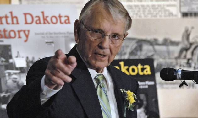 "FILE - In this April 30, 2010 file photo, former North Dakota Gov. George Sinner speaks at an event in his honor in Bismarck, N.D. Sinner, a Casselton native, wants new regulations placed upon railroads that transport crude oil from the state. He says the derailment of tanker cars and ensuing fire outside Casselton on Dec. 30, 2013, shows what he calls a ""ridiculous threat"" to communities across the United States. The fire burned for more than 24 hours and set off a series of massive explosions. Casselton residents were told to evacuate. There were no injuries. (AP Photo/The Bismarck Tribune, Tom Stromme, File)"