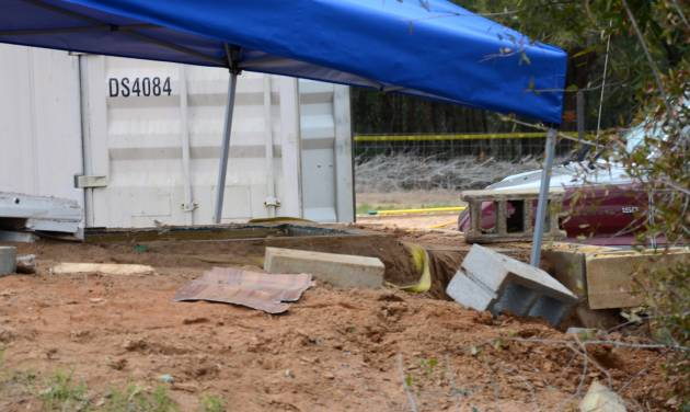 In this undated photo released by the FBI on Tuesday, Feb. 5, 2013, a tent covers the bunker where where a 5-year-old child was held for a week by Jimmy Lee Dykes in Midland City, Ala. The boy was rescued and his captor was killed when federal agents raided the bunker on Monday. (AP Photo/FBI)