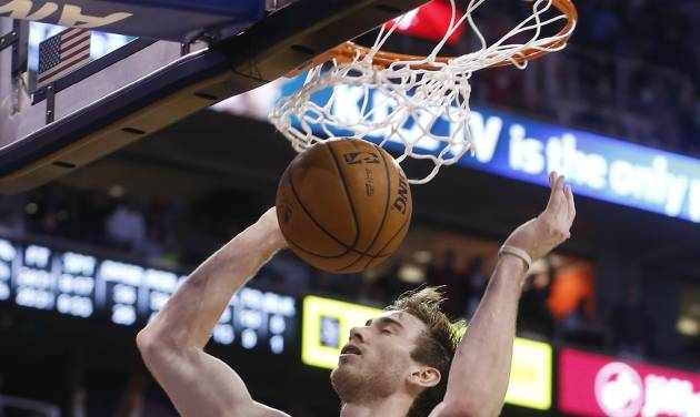 Utah Jazz guard Gordon Hayward (20) gets a dunk against the Oklahoma City Thunder during the second half of an NBA basketball game in Salt Lake City, Tuesday, Jan. 7, 2014. The Jazz won 112-101. (AP Photo/Jim Urquhart)