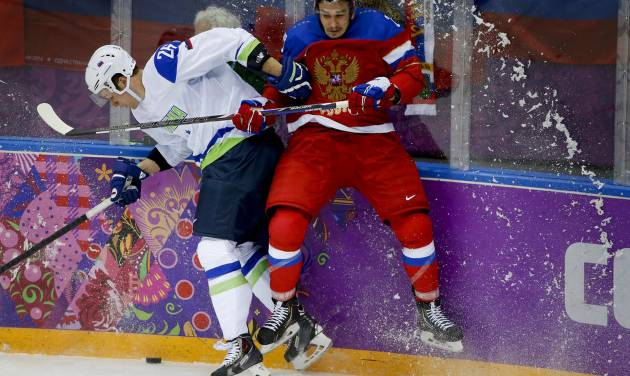 Russia defenseman Vyacheslav Voinov, right, collides with Slovenia forward Jan Urbas in the second period of a men's ice hockey game at the 2014 Winter Olympics, Thursday, Feb. 13, 2014, in Sochi, Russia. (AP Photo/Mark Humphrey)