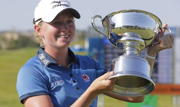 Stacy Lewis displays the trophy after winning the Navistar LPGA Classic golf tournament on Sunday, Sept. 23, 2012, at the Robert Trent Jones Golf Trail in Prattville, Ala. (AP Photo/Dave Martin)