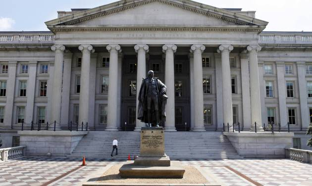 FILE - In this Monday, Aug. 8, 2011 file photo, a statue of former Treasury Secretary Albert Gallatin stands outside the Treasury Building in Washington. The Treasury reports on the federal budget deficit for May, on Wednesday, June 12, 2013. (AP Photo/Jacquelyn Martin, File)
