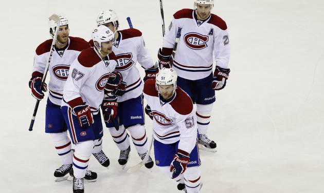 Montreal Canadiens' Max Pacioretty (67) celebrates with Brandon Prust (8), Raphael Diaz (61), Josh Gorges (26) and David Desharnais (51) and after scoring a goal during the second period of an NHL hockey game against the New York Rangers, Tuesday, Feb. 19, 2013, in New York. (AP Photo/Frank Franklin II)