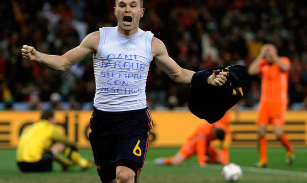 """FILE - In this July 11, 2010 file photo, Spain's Andres Iniesta celebrates after scoring a goal, with the words """"Dani Jarque, always with us"""", written on his undershirt, during the World Cup final soccer match between the Netherlands and Spain, at Soccer City in Johannesburg, South Africa. On this day: Four minutes from the end of extra time, Iniesta scores to win the World Cup for Spain for the first time. (AP Photo/Martin Meissner, File)"""