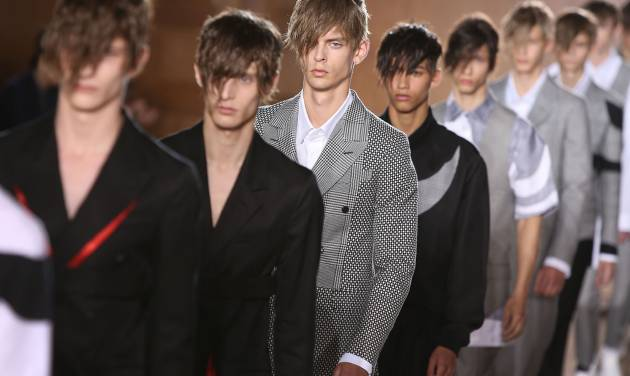 Models wear creations by Alexander McQueen during London Men's spring summer fashion collections 2015, at the Royal College of Surgeons of England by Lincoln's Inn Fields, central London, Monday, June 16, 2014. (Photo by Joel Ryan/Invision/AP)