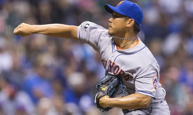 New York Mets' Daisuke Matsuzaka gives up a home run to Milwaukee Brewers' Khris Davis during the sixth inning of a baseball game Thursday, July 24, 2014, in Milwaukee. (AP Photo/Tom Lynn)