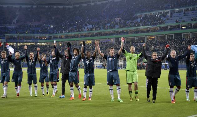 Bayern's team celebrates after winning the  quarterfinal match of the German soccer cup between Hamburger SV and Bayern Munich in Hamburg, Germany, Wednesday, Feb. 12, 2014. Bayern won 5-0. (AP Photo/Martin Meissner)