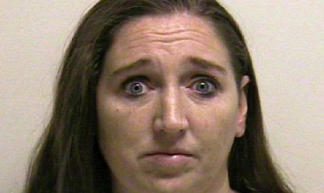 This photo provided by the Utah County jail shows Megan Huntsman, who was booked into the Utah County jail on suspicion of killing six of her newborn children over the past decade. Seven dead babies were found in a garage at a Pleasant Grove home where Huntsman lived up until 2011. (AP Photo/Utah County Jail) Courtesy Utah County Jail