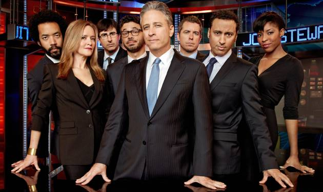 """This undated image released by Comedy Central shows, from left, Wyatt Cenac, Samantha Bee, John Oliver, Al Madrigal, Jon Stewart, Jason Jones, Aasif Mandvi and Jessica Williams from """"The Daily Show with Jon Stewart."""" The popular political satire show will be covering the Republican National Convention this week and will shift its regular schedule a day to broadcast four shows from Tampa Tuesday through Friday. (AP Photo/Comedy Central, Martin Crook)"""