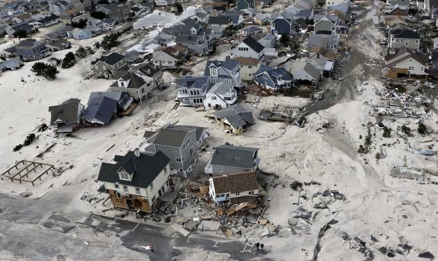 FILE - In this Oct. 31, 2012 file photo, a view from the air shows the destroyed homes left in the wake of Superstorm Sandy in Seaside Heights, N.J. New Jersey got the brunt of Sandy, which made landfall in the state and killed six people. A presidential task force charged with developing a strategy for rebuilding coastal areas damaged by Sandy will issue a report on Monday, Aug. 19, 2013, recommending 69 measures that might help insure that coastal areas aren't as vulnerable to future storms in an age of rising sea levels. (AP Photo/Mike Groll, File)