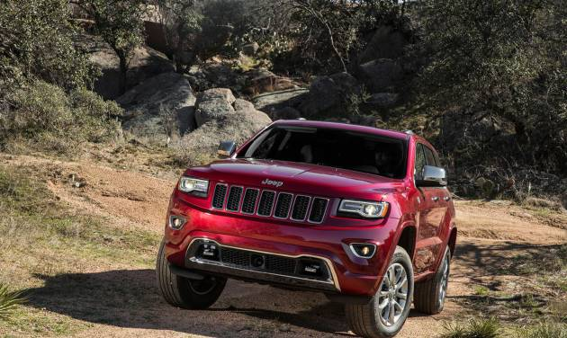 This undated product photo provided by Chrysler Group shows the 2014 Jeep Grand Cherokee. Chrysler Group on Wednesday, Aug. 6, 2014 reported that it made $619 million in the April-through-June quarter, compared with $507 million a year ago. (AP Photo/Chrysler Group)