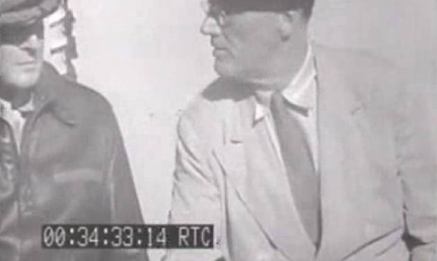 This image from an eight-second film clip provided by the National Archives shows President Franklin Delano Roosevelt, right, aboard the U.S.S. Baltimore in Pearl Harbor in July 1944, depicting a secret not revealed to the public until after his death. Person at left is unidentified. (AP Photo/National Archives)