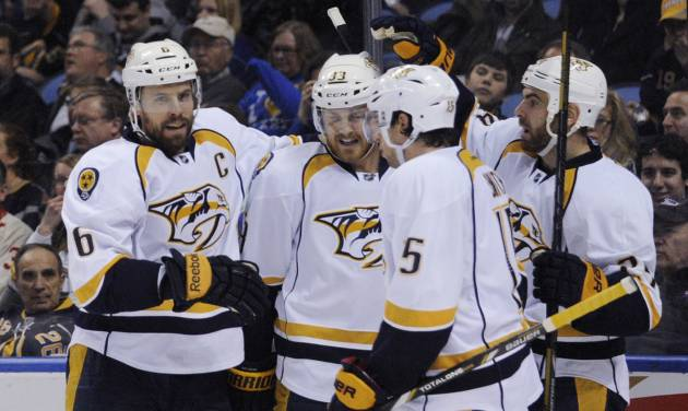 Nashville Predators' Shea Weber (6), Colin Wilson (33), Craig Smith (15) and Eric Nystrom celebrate a goal by Weber during the second period of an NHL hockey game against the Buffalo Sabres in Buffalo, N.Y., Tuesday, March 11, 2014. (AP Photo/Gary Wiepert)