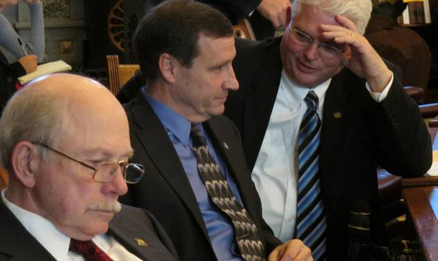 Kansas state Sen. Pat Apple, right, a Louisburg Republican, confers with Sen. Dennis Pyle, center, a Hiawatha Republican, during the Senate's debate on a measure banning sex-selection abortion, Tuesday, Feb. 19, 2013, at the Statehouse in Topeka, Kan. Sitting to their left is Sen. Les Donovan, a Wichita Republican. (AP Photo/John Hanna)